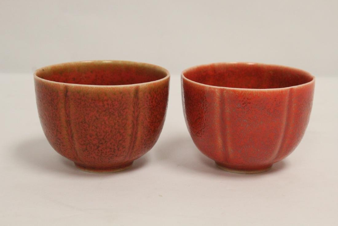 2 red glazed porcelain tea bowls