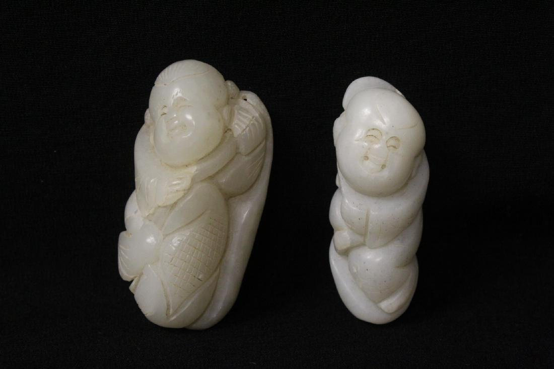 2 white jade carved figures