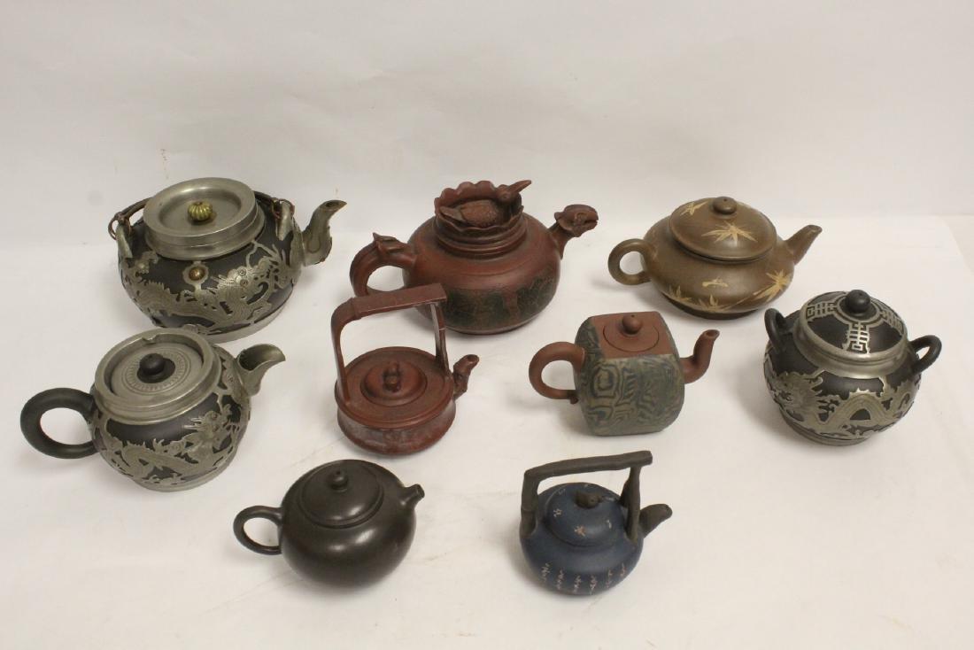 9 Yixing teapots