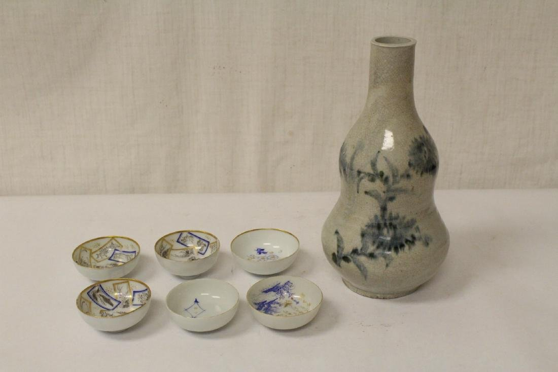 Blue and white wine bottle, and 6 sake cups