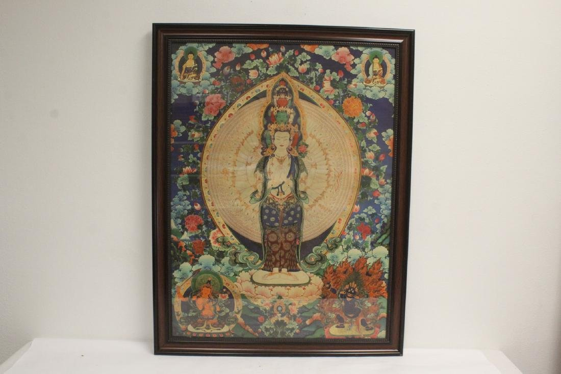 A framed print on silk thangka