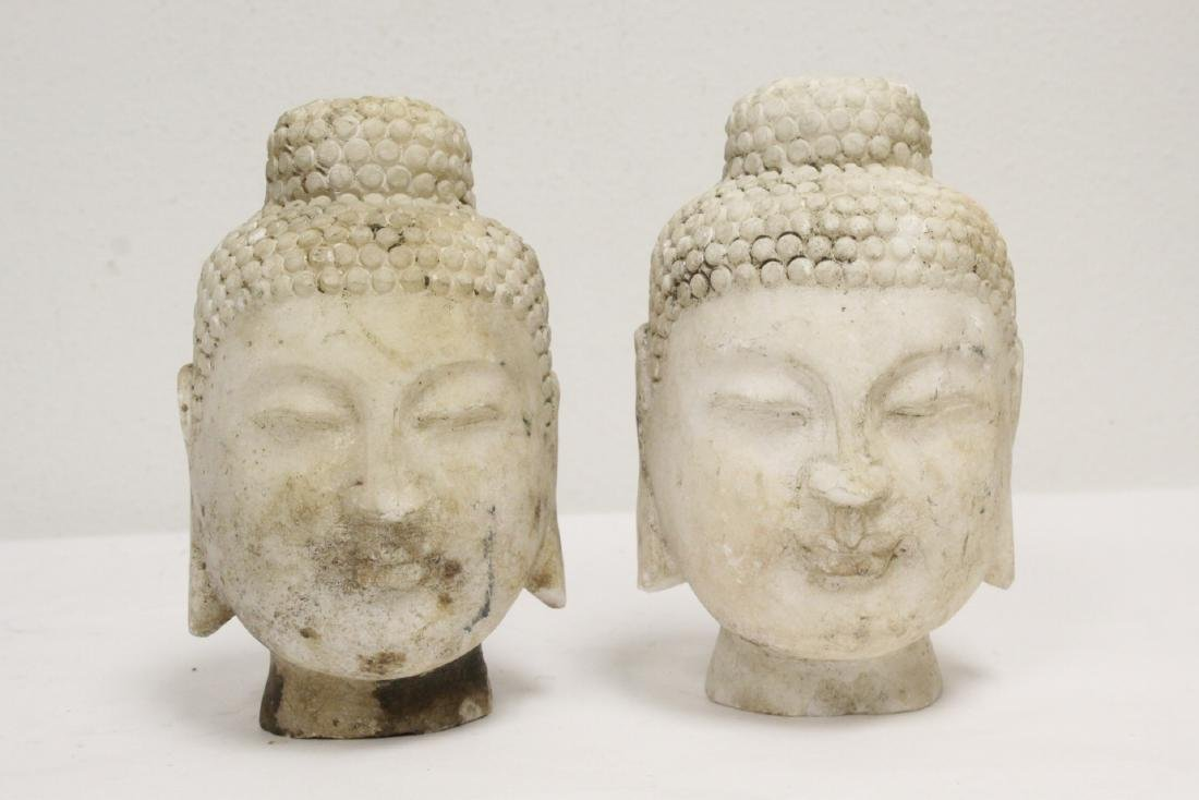 2 marble carved Buddha heads