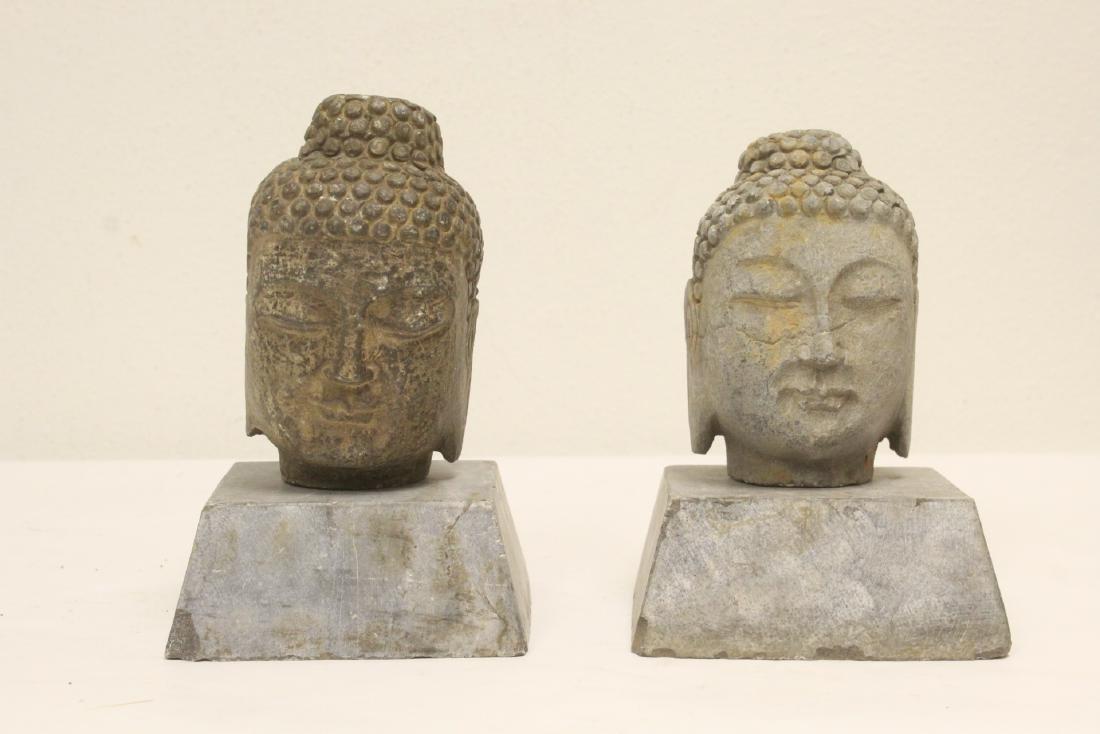 2 stone carved Buddha head