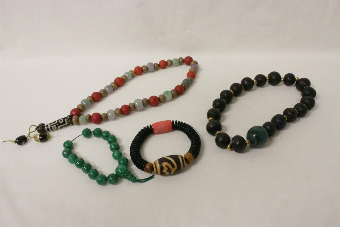 2 various bead necklaces, and 2 bead bracelets