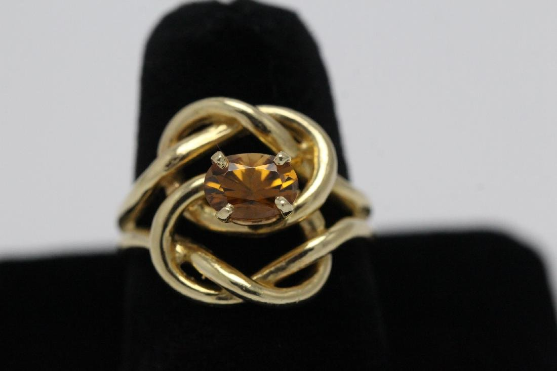 A beautiful twist design 14K rose gold ring