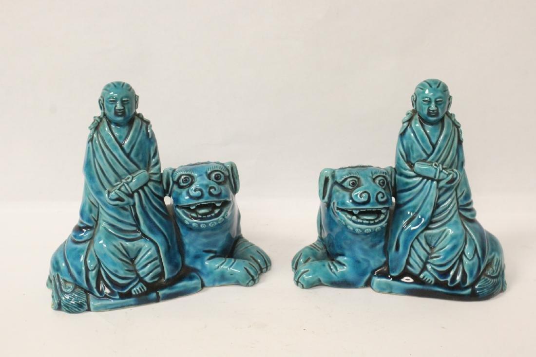 2 turquoise glazed figures