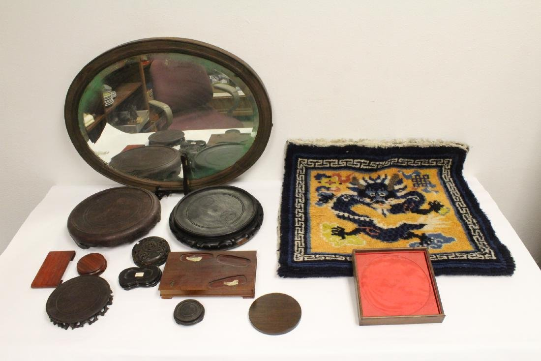 Lot of wood stands, a wall mirror and a Chinese rug