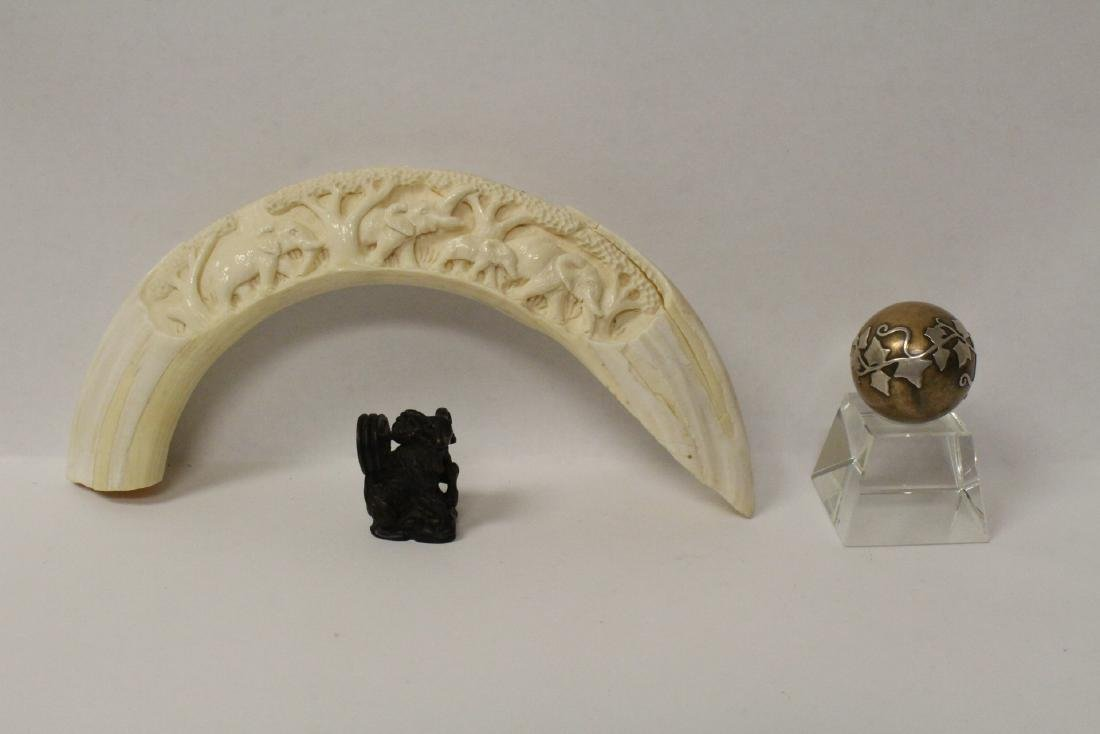 Carved boar tusk, a wood netsuke and a ball on stand