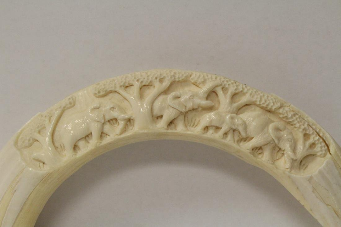 Carved boar tusk, a wood netsuke and a ball on stand - 3