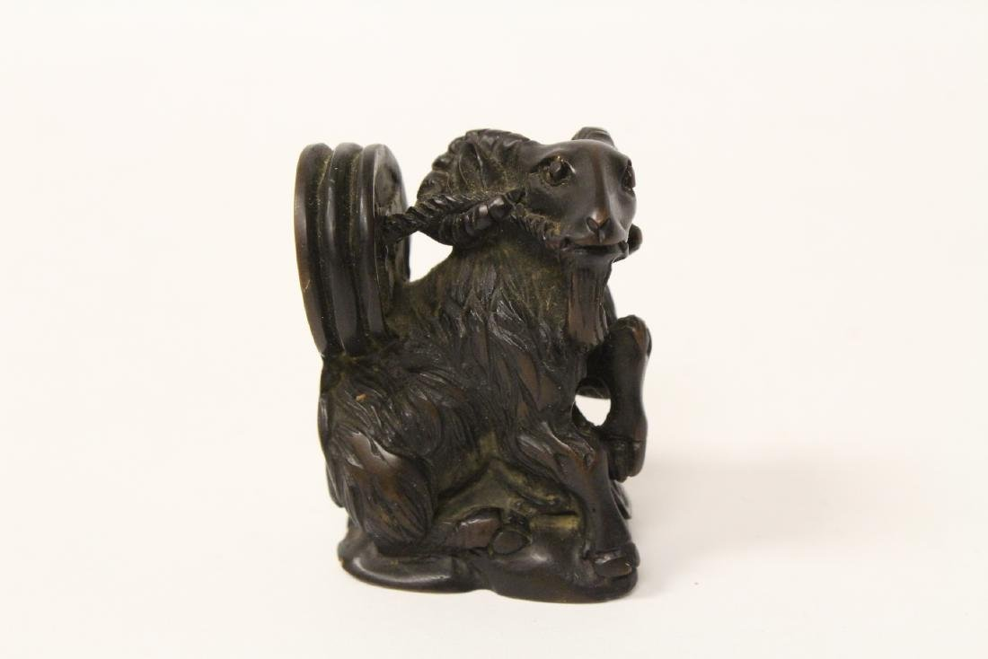 Carved boar tusk, a wood netsuke and a ball on stand - 6