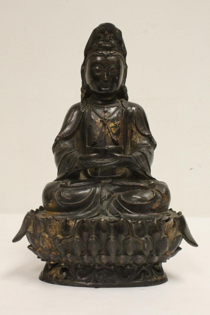 Chinese bronze sculpture of Guanyin on bronze stand