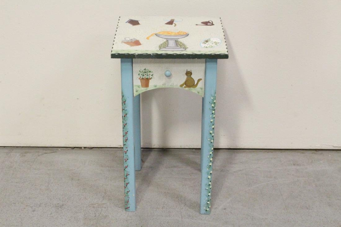A painted lamp table by Kathy Hatch collection