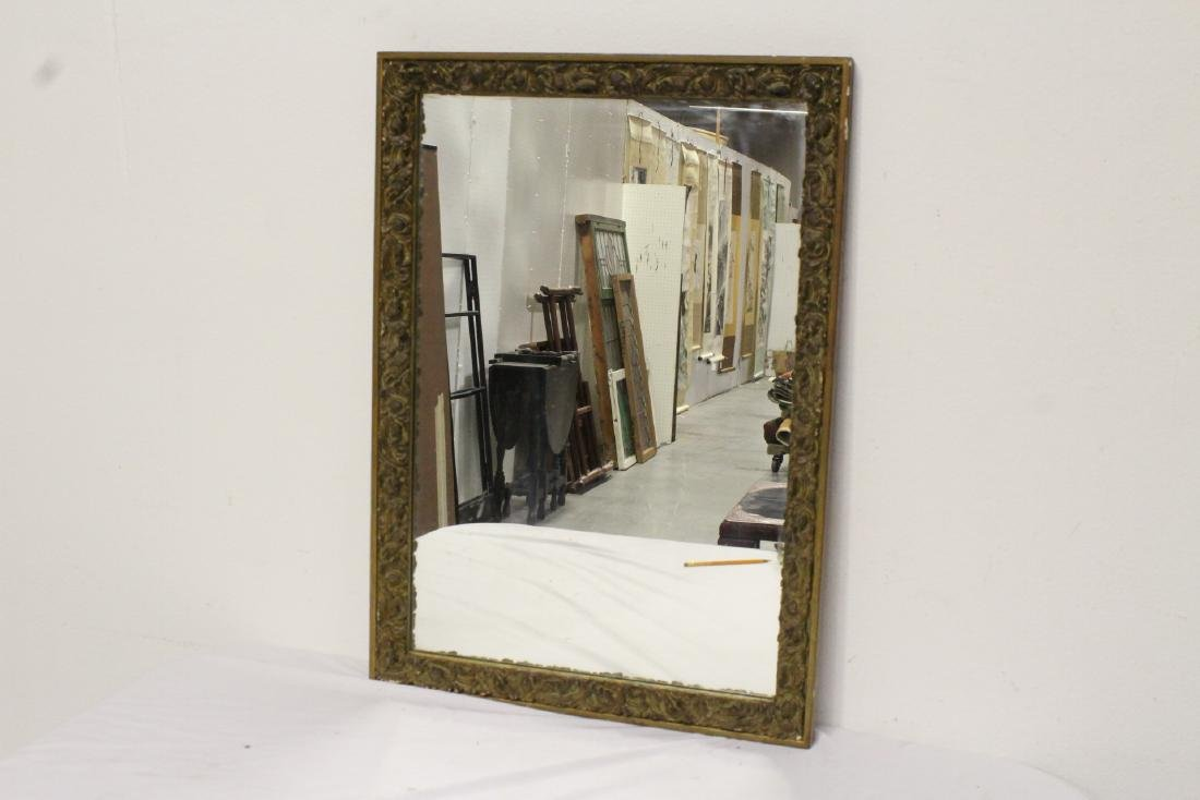 19th century carved and gilt wood mirror