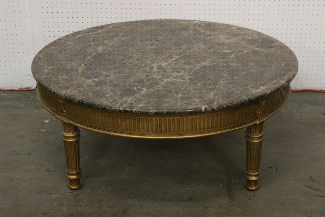 A fine French gilt wood marble top round table
