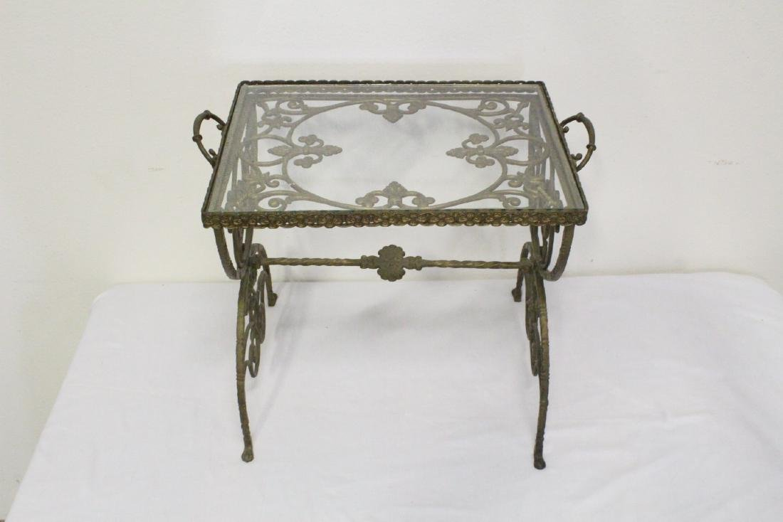 A beautiful Victorian cast iron stand with glass top