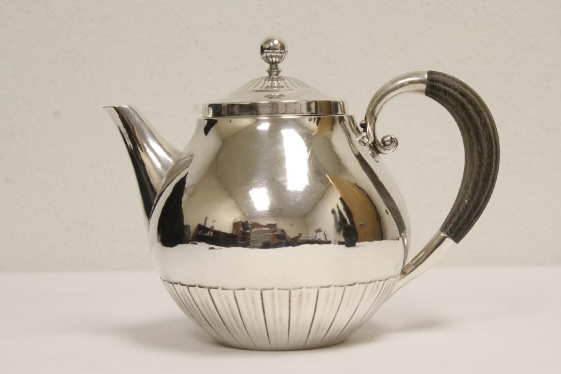 A fine sterling silver teapot by Georg Jensen