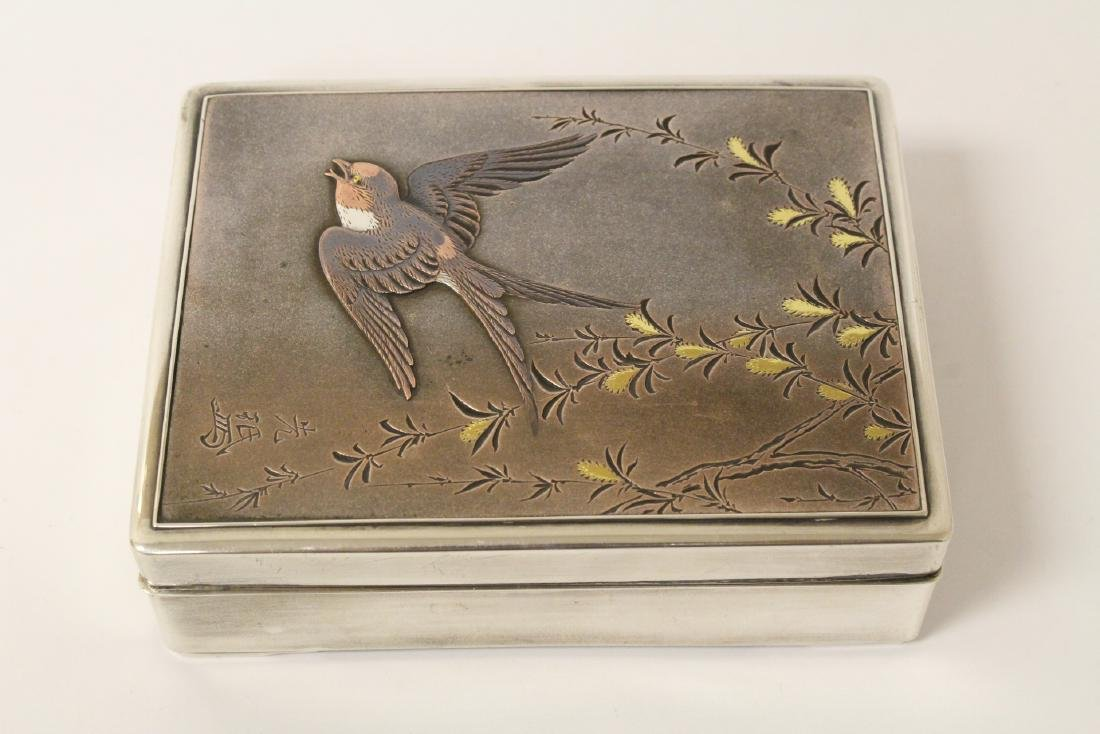A silver and rosewood box, signed by artist