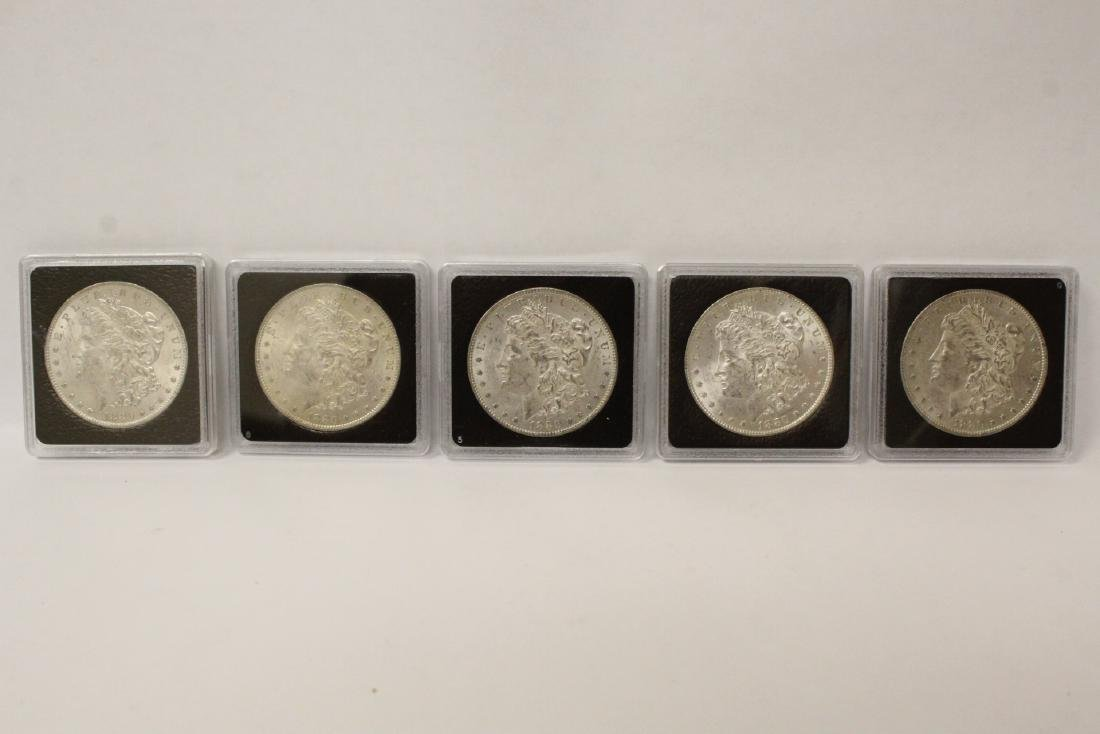 Five 1882-O Morgan silver dollars