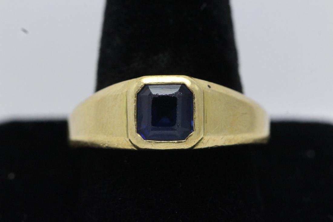 An 18K Y/G ring by Gucci