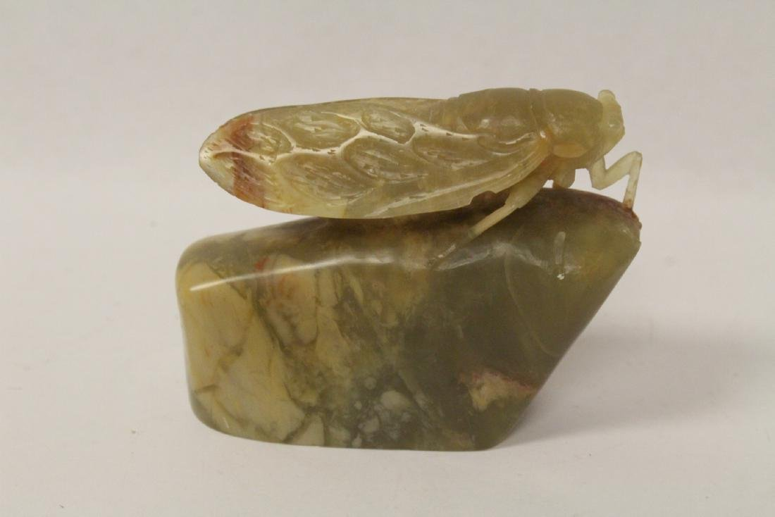Chinese jade carving depicting cricket on rock