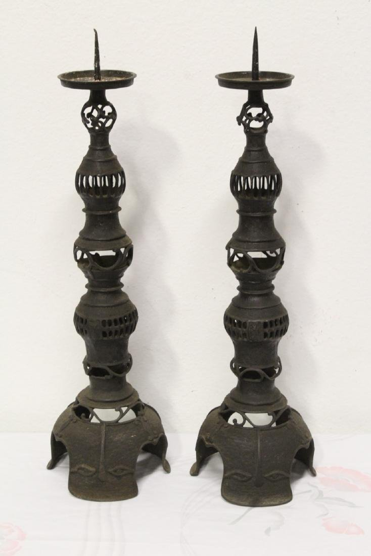 Pair Japanese antique cast iron candle holders
