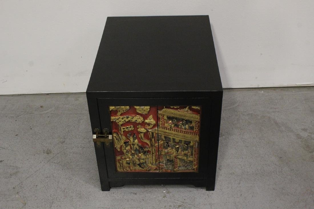 Chinese hardwood cabinet with carved panel