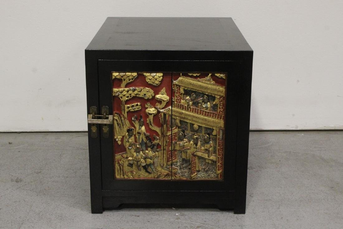 Chinese hardwood cabinet with carved panel - 2