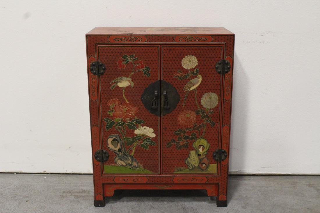A beautiful Chinese red lacquer cabinet