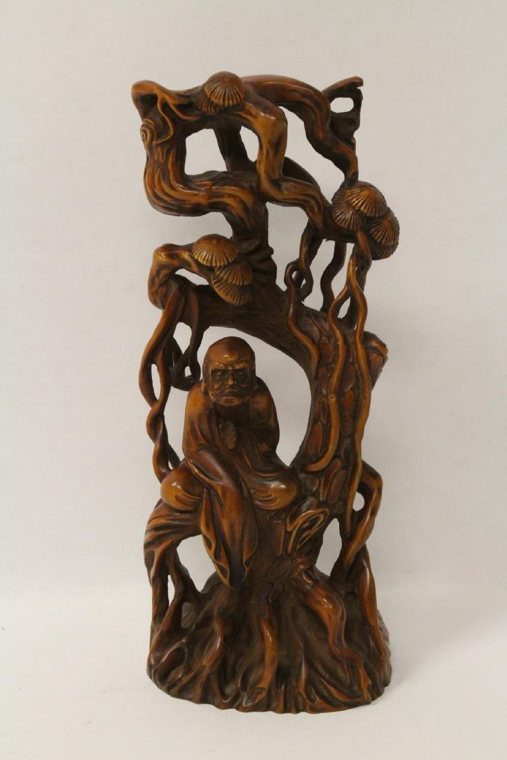 Wood carved figure