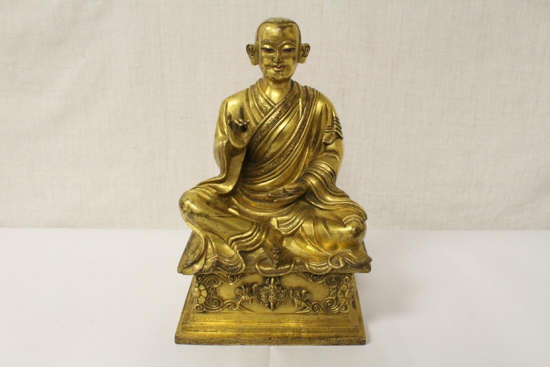 Chinese gilt bronze sculpture of seated Buddha