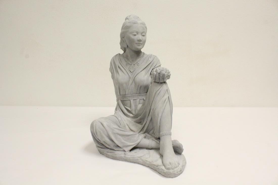 A fine casted figure of seated lady
