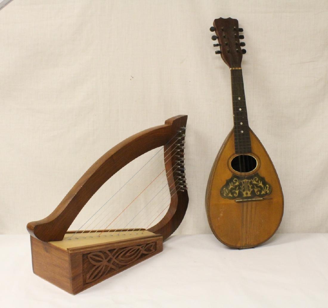 Vintage mandolin and a small harp