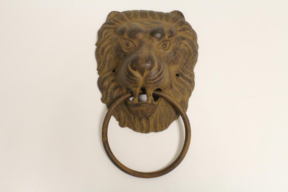 Large bronze/cast iron door knocker in lion motif