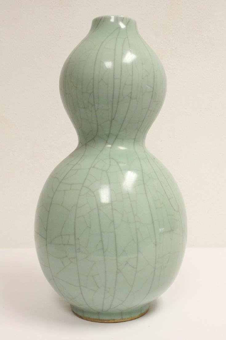 Large Chinese celadon gourd shape vase, drilled