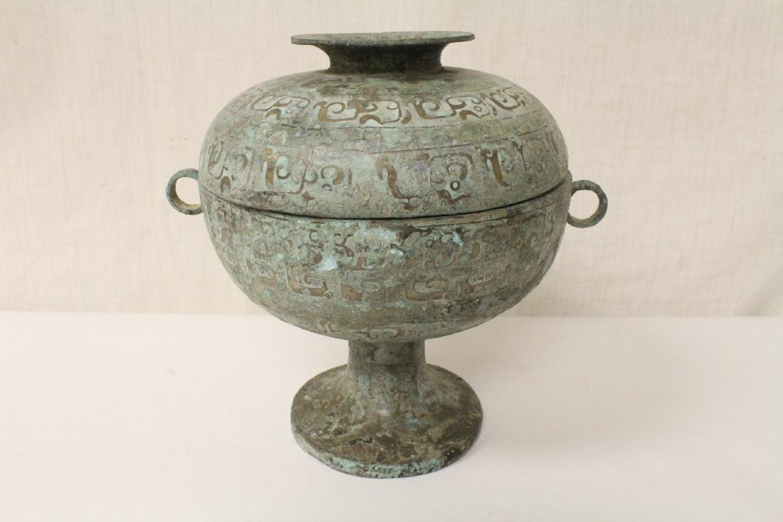 Chinese archaic style bronze covered bowl