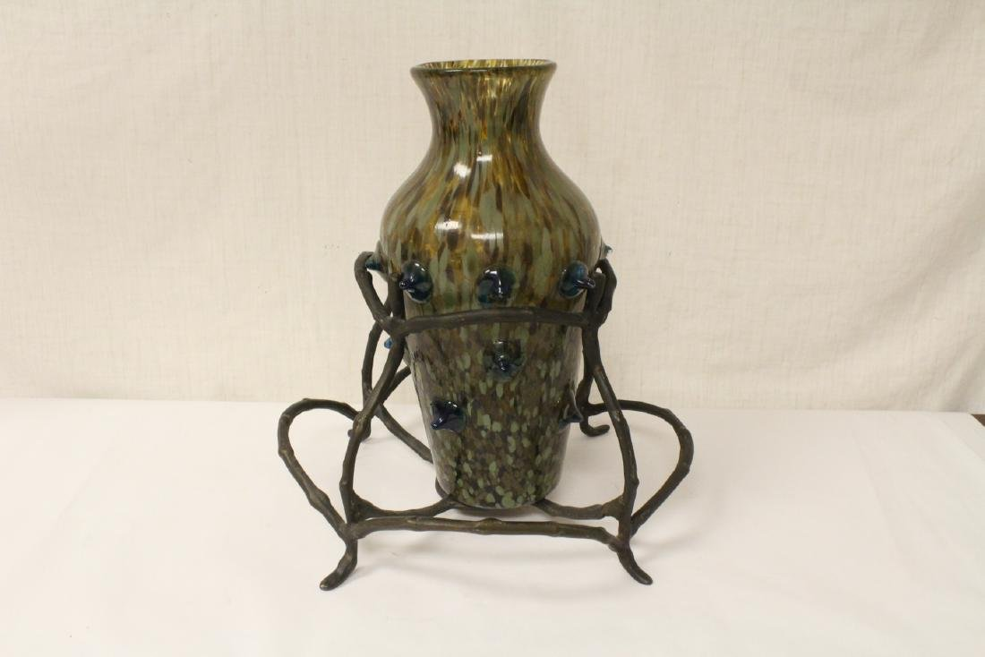 A beautiful art glass vase with bronze stand