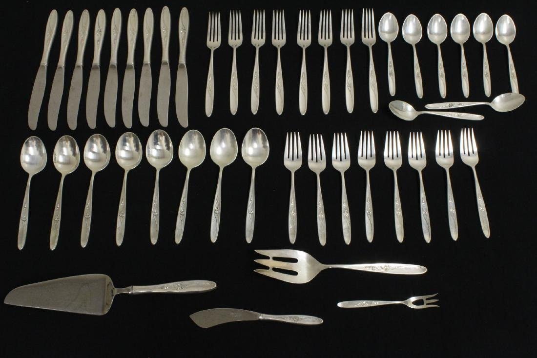 Set of serving for 8 flatware by Towl