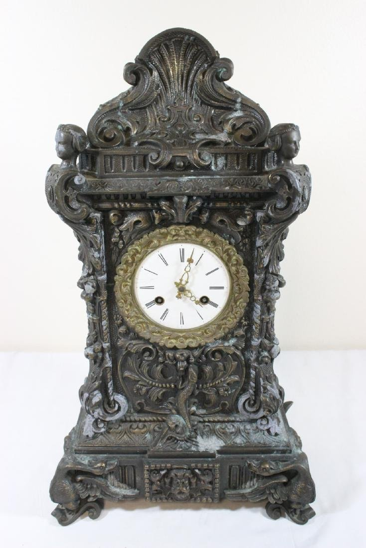 Casted metal table clock