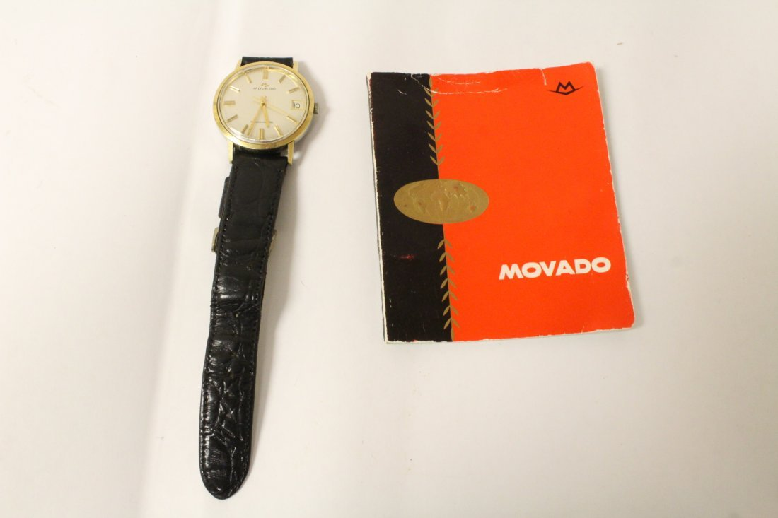 A vintage Movado wrist watch w/ original booklet