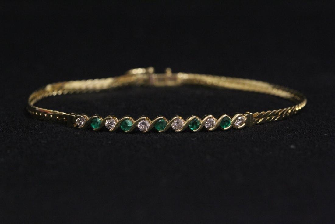 18K Y/G diamond and emerald bracelet