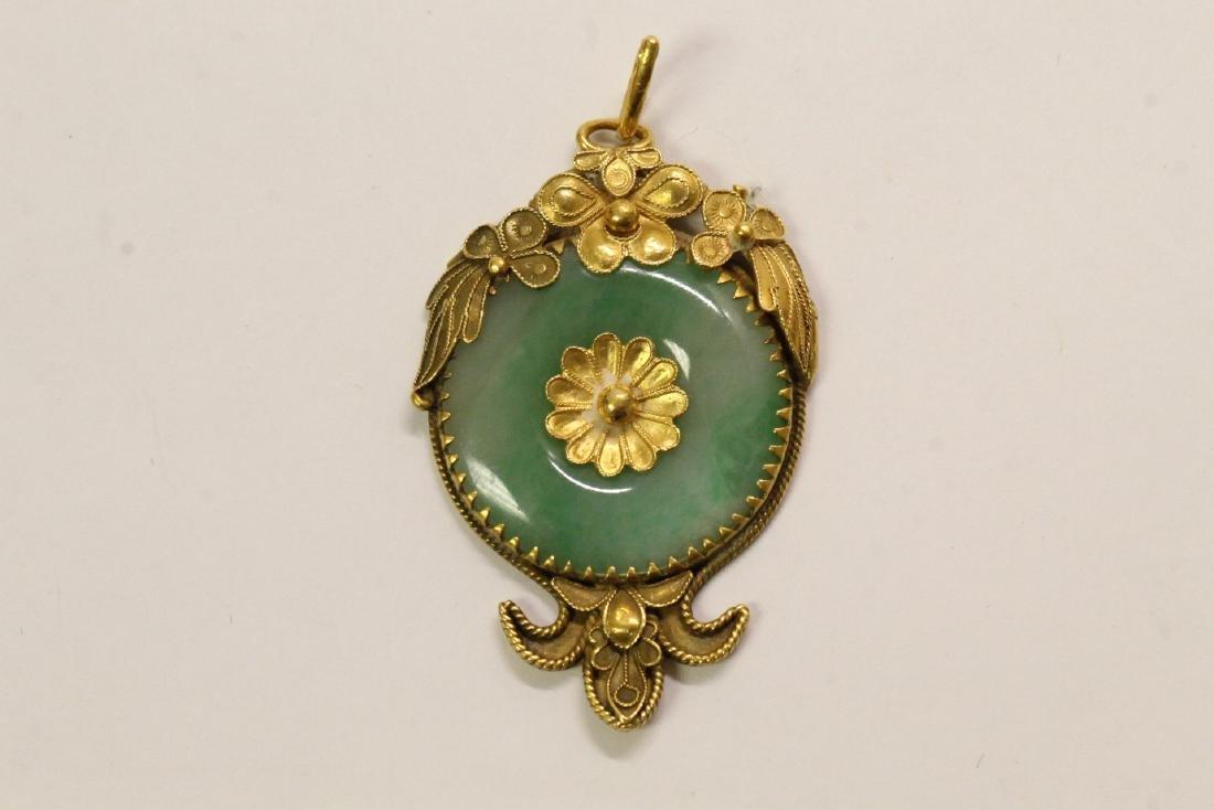 A 24K gold jadeite pendant