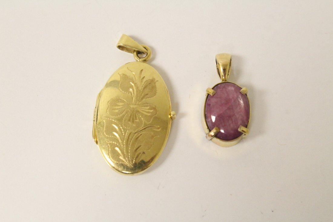 14K star ruby pendant, and a 14K picture locket