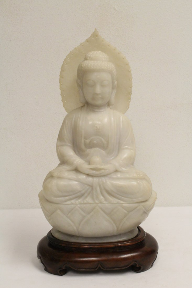 An important Chinese white jade carving