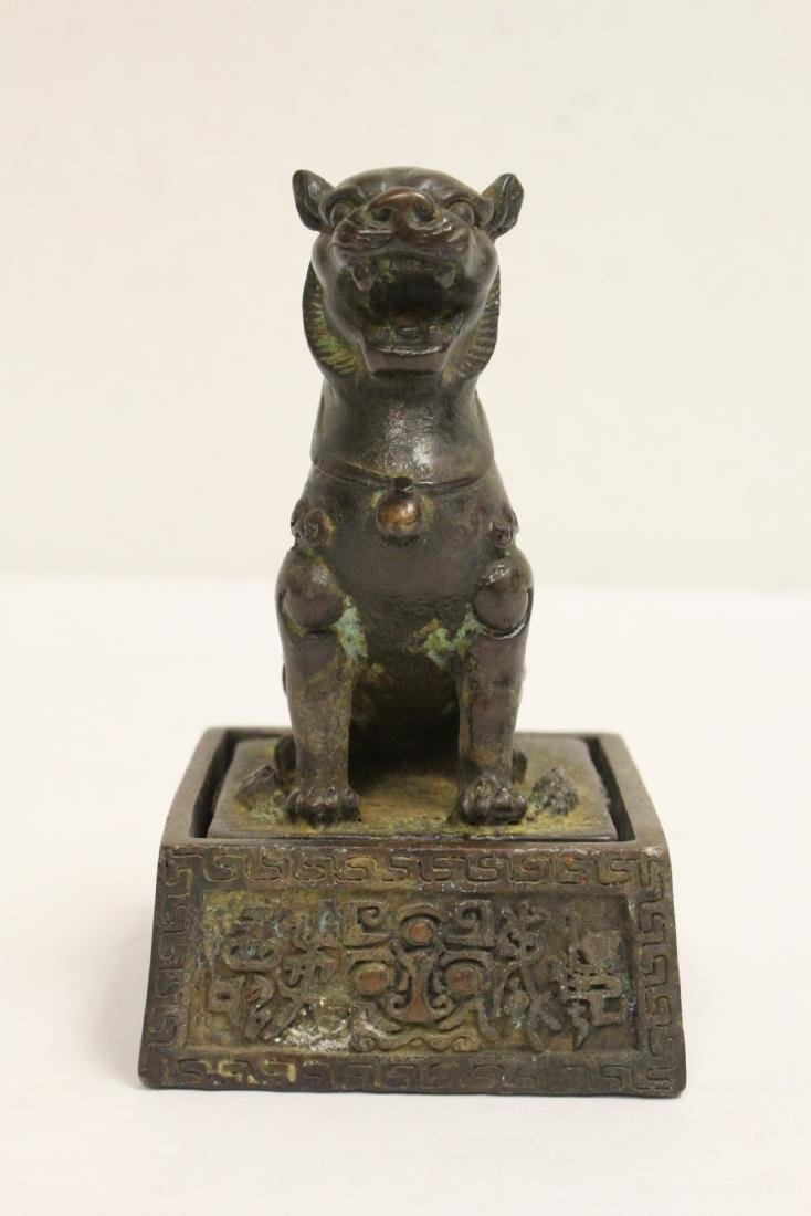 Chinese bronze seal with bronze base