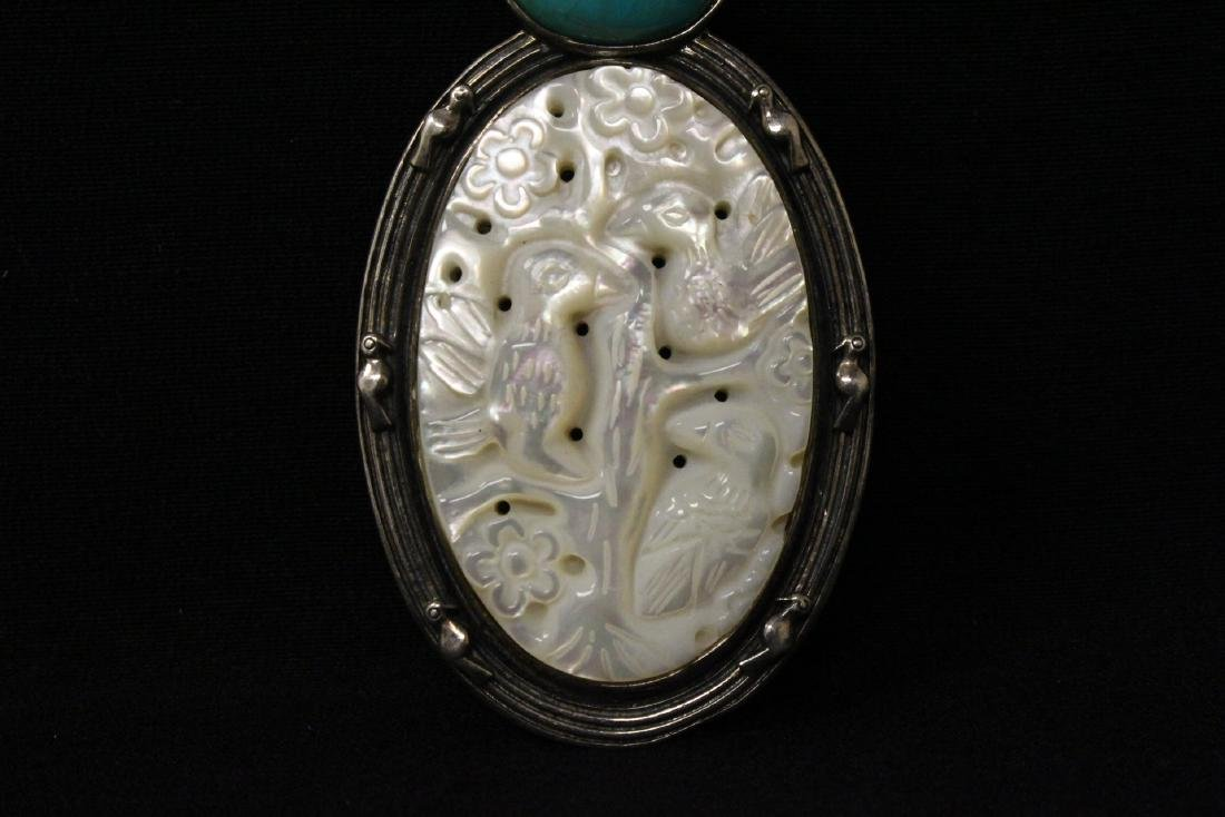 A silver brooch with mother of pearl plaque - 2