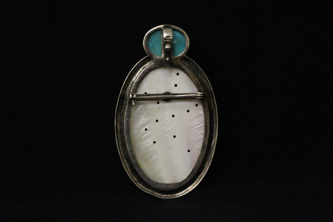 A silver brooch with mother of pearl plaque - 8