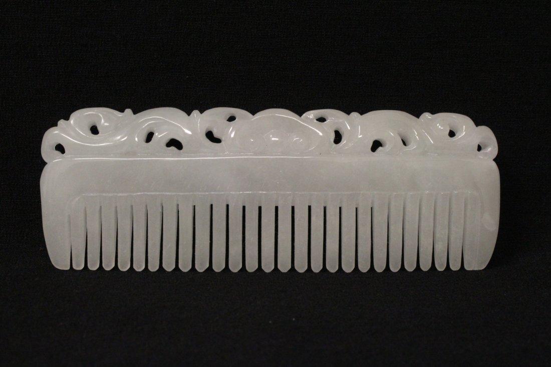A rare white jadeite carved comb