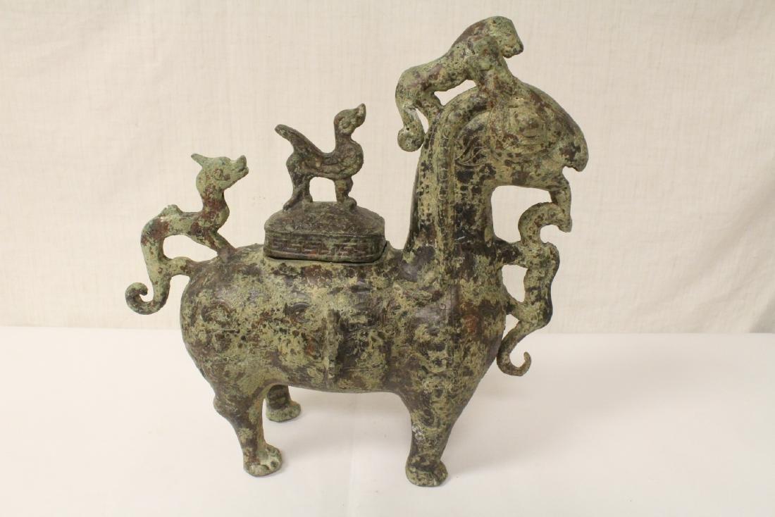 Very ornate Chinese bronze wine server