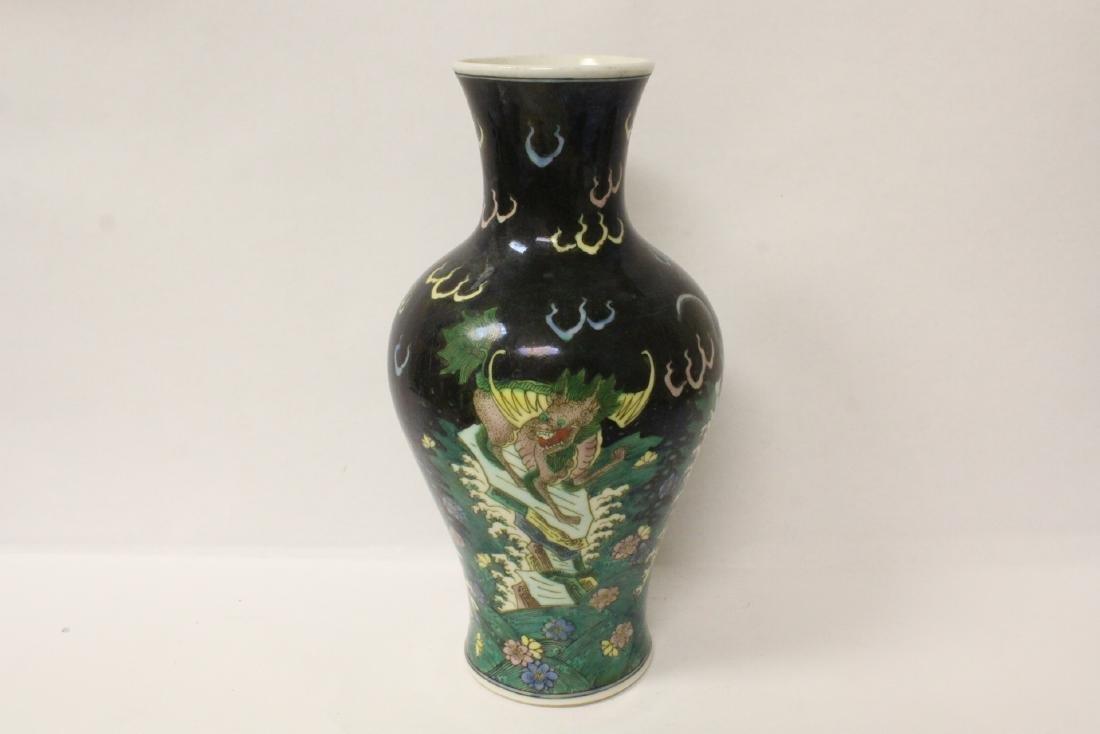 Chinese black background famille rose vase
