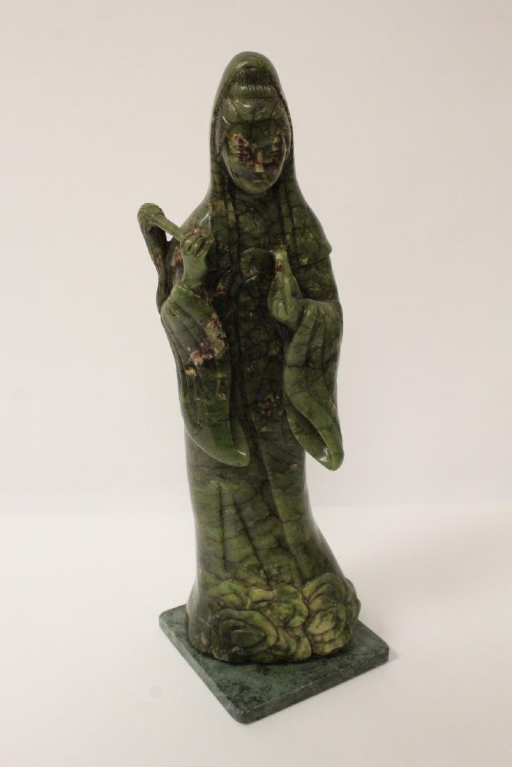 An important Chinese antique green jade carving